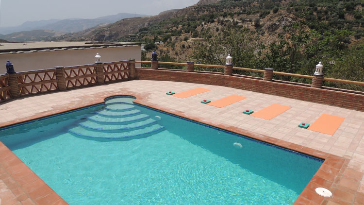 pool side yoga at House of Light, retreat centre, Andalusia, Spain